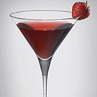 Drinkkilasi ja mansikka.